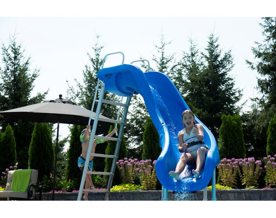 Thumbnail for A little girl slides down a blue Rogue2 pool slide